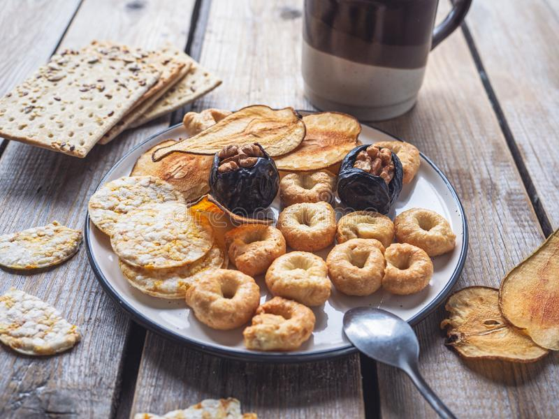 A quick lunch with cereal biscuits and dried fruit chips stock image