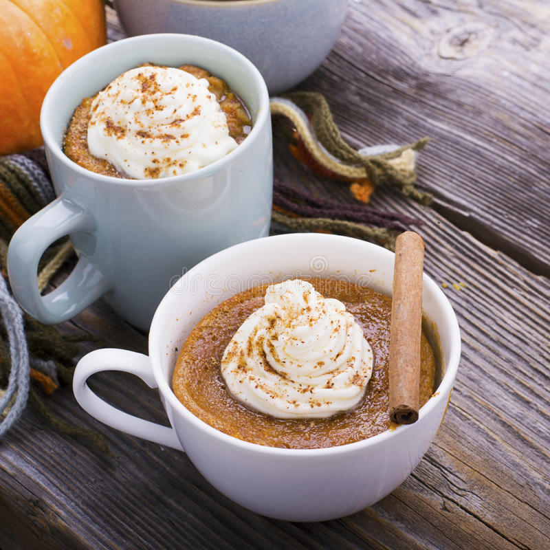 Quick meal breakfast snack in the microwave. Fragrant homemade pumpkin pie fall for five minutes in the cup portions royalty free stock image