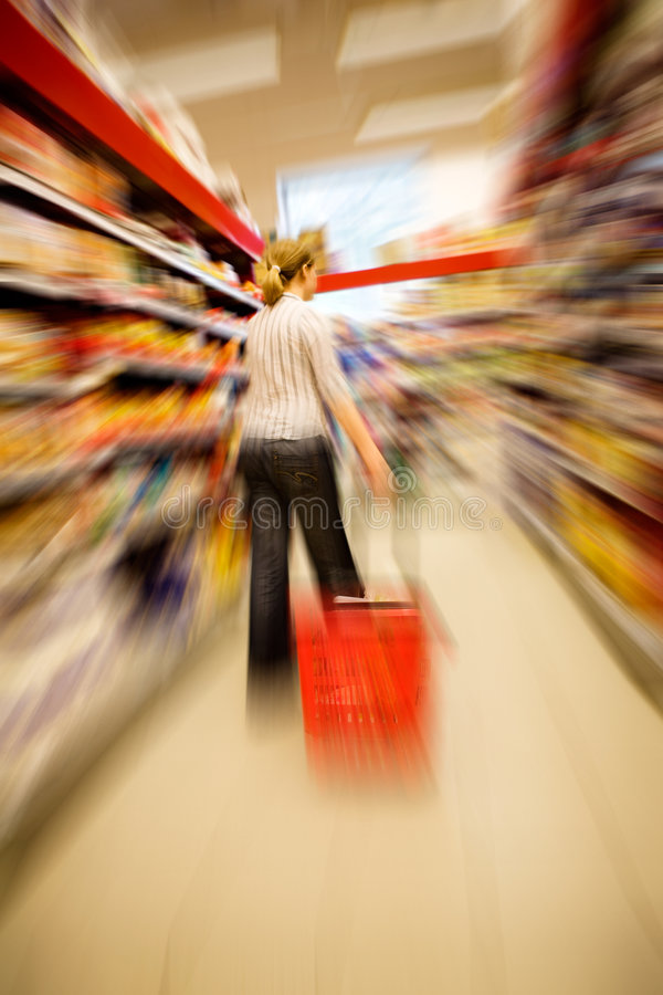 Quick Shopping. A woman shopping with zooming blur stock photos