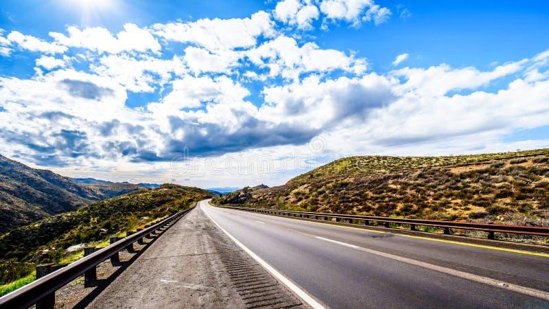 Arizona State Highway SR87 as it winds through the McDowell Mountain Range in Northern Arizona. The quiet Arizona State Highway SR87 as it winds through the stock photo