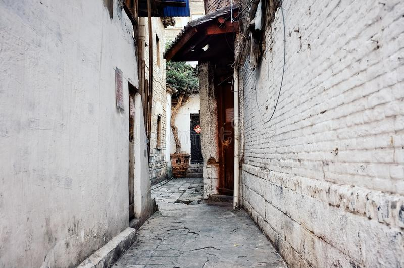 Quiet backstreet mood with rusty doors and a tree. Quiet backstreet mood at beijing china with rusty doors and a tree stock photos