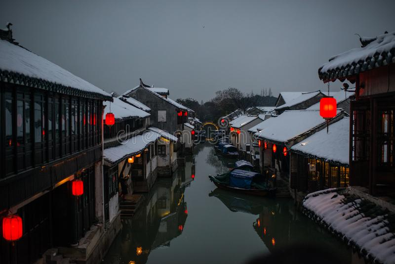 Quiet China ancient water town village in snow dark, zhouzhuang, suzhou. Chinese ancient water town village in zhouzhuang, suzhou, jiangsu. Taken in a snow day royalty free stock photos