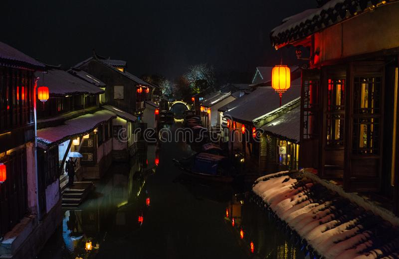 Quiet China ancient water town village in snow dark, zhouzhuang, suzhou. Chinese ancient water town village in zhouzhuang, suzhou, jiangsu. Taken in a snow day royalty free stock photography