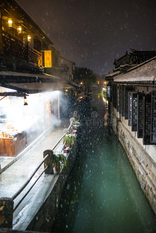 Quiet China ancient water town village in snow dark, zhouzhuang, suzhou. Chinese ancient water town village in zhouzhuang, suzhou, jiangsu. Taken in a snow day stock photography