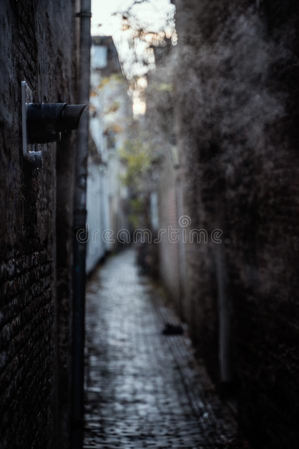 Quiet Dark Alley with Exhaust Pipes Blowing Steam Daytime City Scene stock photography