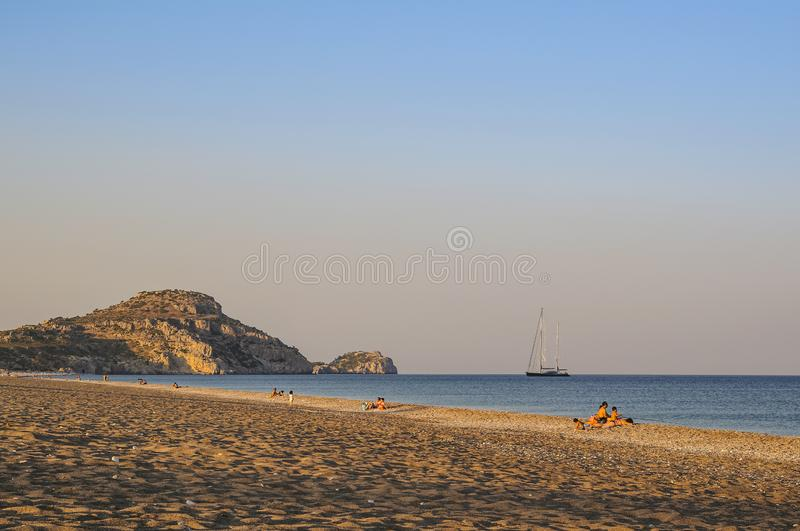 A quiet evening and people relaxing on the shores of the Mediterranean Sea at sunset. Greece. stock photos
