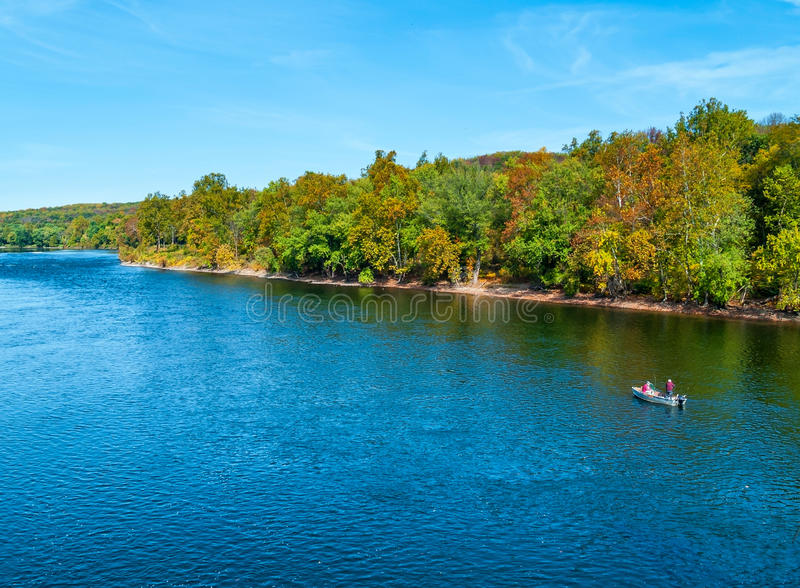 Quiet Fishing on the Delaware. A scenic Autumn view of the Delaware River near Washington Crossing in Bucks County Pennsylvania royalty free stock images