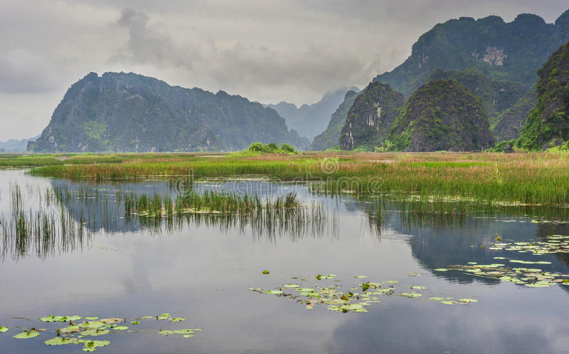 Lake near old mountains in Vietnam royalty free stock photography