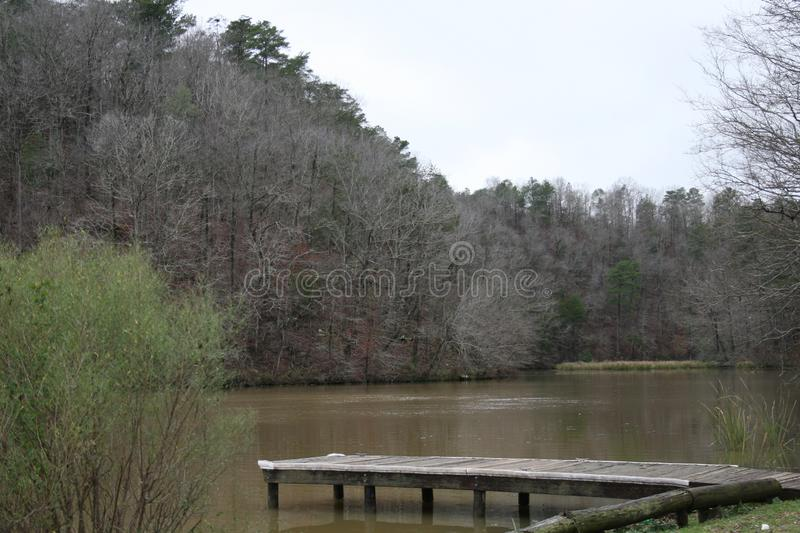Quiet Little Cove in Alabama 2019. For most people winter months are not months to go to the forest to see natures beauty. Here you are able to see the hills of royalty free stock image