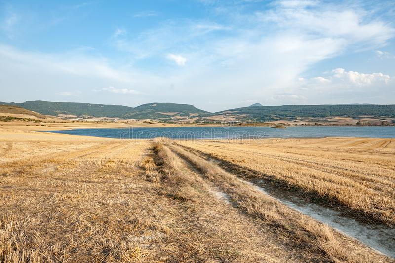 Country road towards the lake in Navarra, Spain royalty free stock image