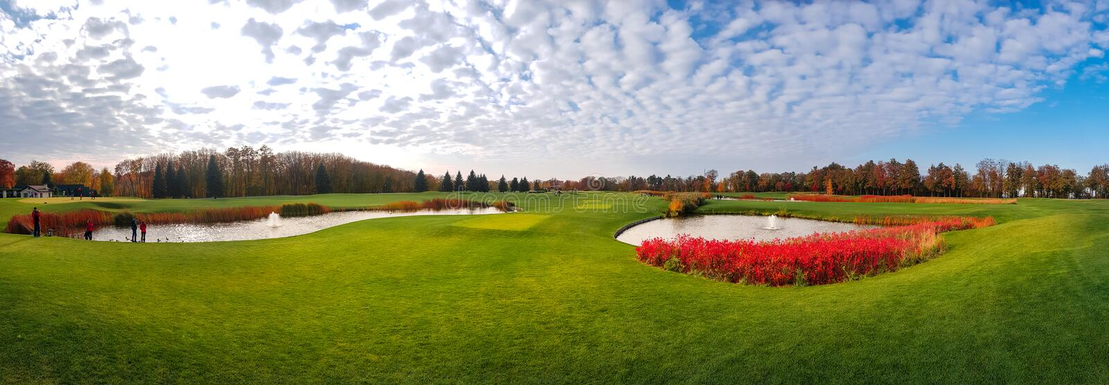 Quiet pond and green meadow in autumn park, nobody. Panorama. October nature and lake, panorama stock photography