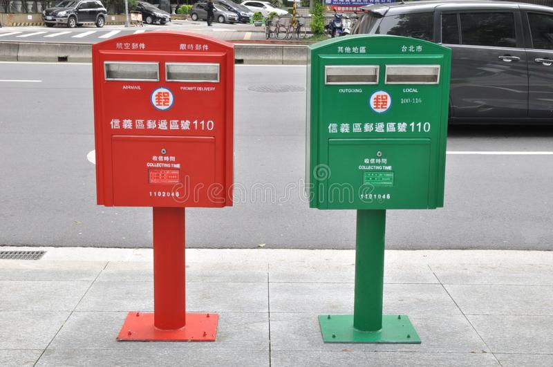 Quiet Red & Green Mail Boxes royalty free stock photography