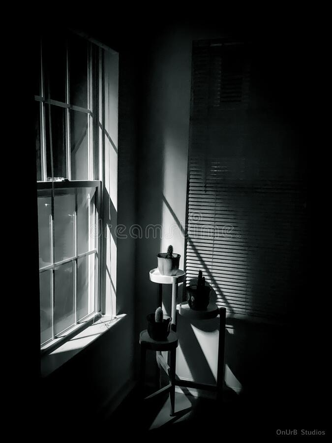 A quiet room at night with some light coming in through the window. A quiet room in the middle of the deep night with some light coming in through the window royalty free stock images