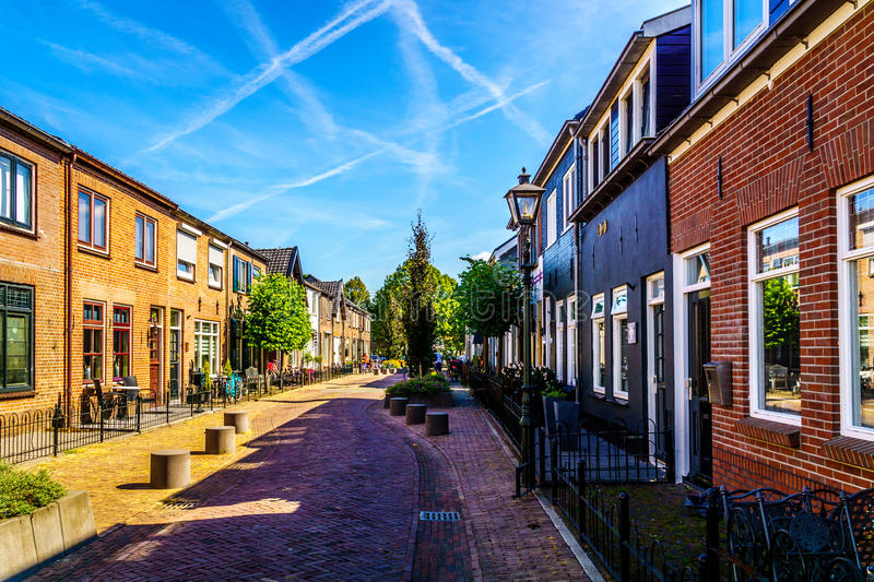 Quiet street in the historic Dutch Fishing Village of Bunschoten-Spakenburg with Renovated Row Houses. On a Sunny Summer day stock images