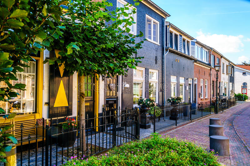 Quiet street in the historic Dutch Fishing Village of Bunschoten-Spakenburg with Renovated Row Houses. On a Sunny Summer day royalty free stock images