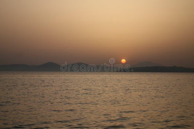 quiet sunset orange disc stock image