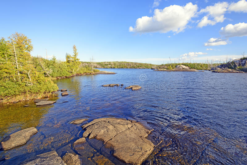 Quiet Waters in Canoe Country. Alpine Lake in the Boundary waters in the evening royalty free stock images