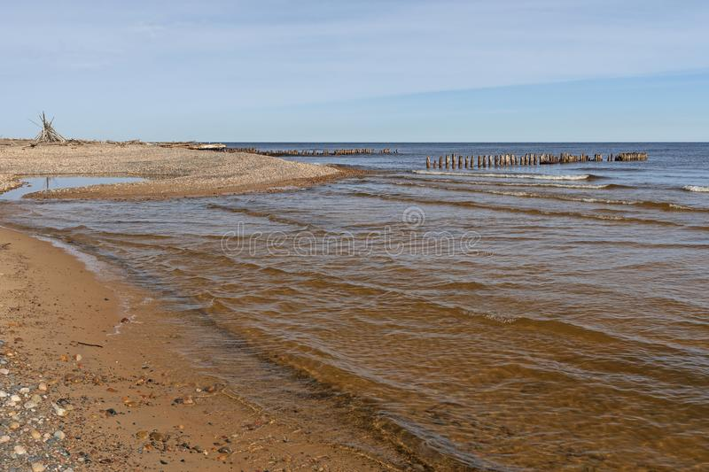 Quiet Waters and Ruins on a Remote Beach on the Great Lakes. On Whitefish Point on Lake Superior in Upper Michigan royalty free stock photos
