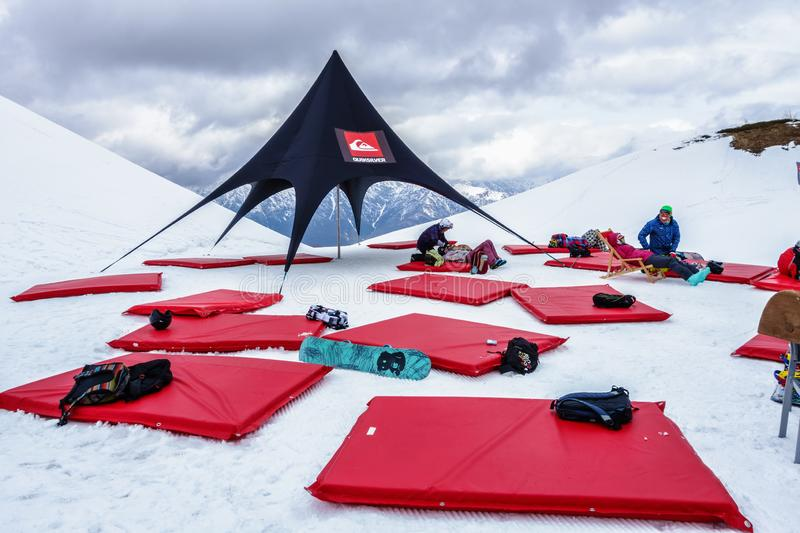 Quiksilver Camp is a winter mountain sports and entertainment activity for skiers and snowboarders. People relaxing apres ski on stock photo