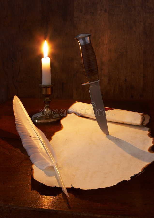 Quill and dagger stock photos