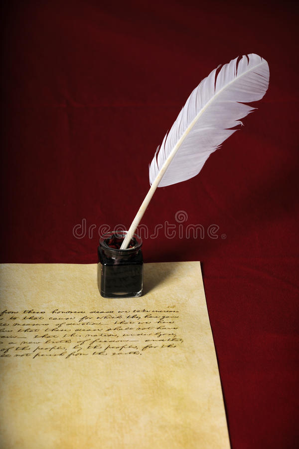Quill and Pen With handwritten Text. Quill, pen and handwritten text on parchment paper - Text is end of Abraham Lincoln's Gettysburg Address royalty free stock images