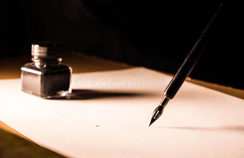 Quill pen ink and paper royalty free stock photography