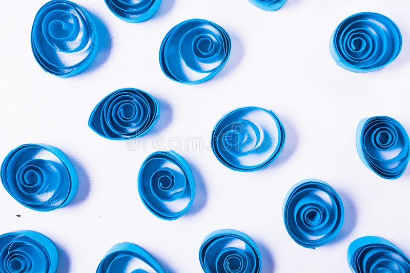 Quilling art. Blue paper curls stock image