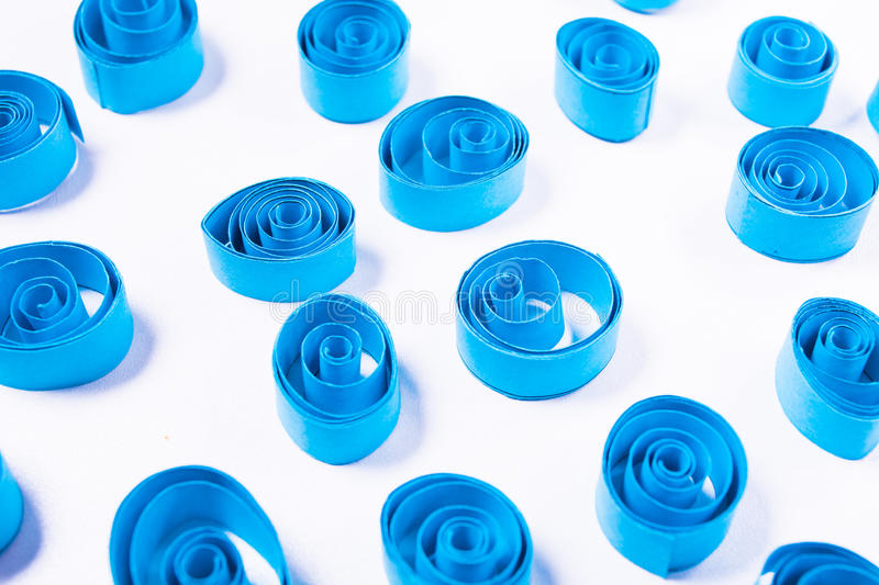 Quilling art. Blue paper curls royalty free stock photos