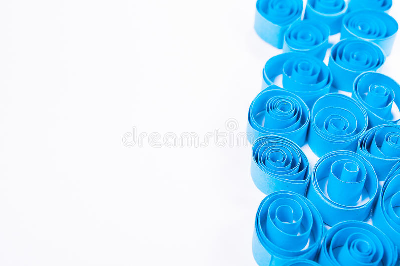 Quilling art. Blue paper curls on the white background royalty free stock images