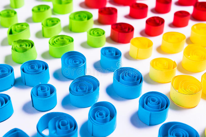 Quilling art. Colorful paper curls on the white background royalty free stock image