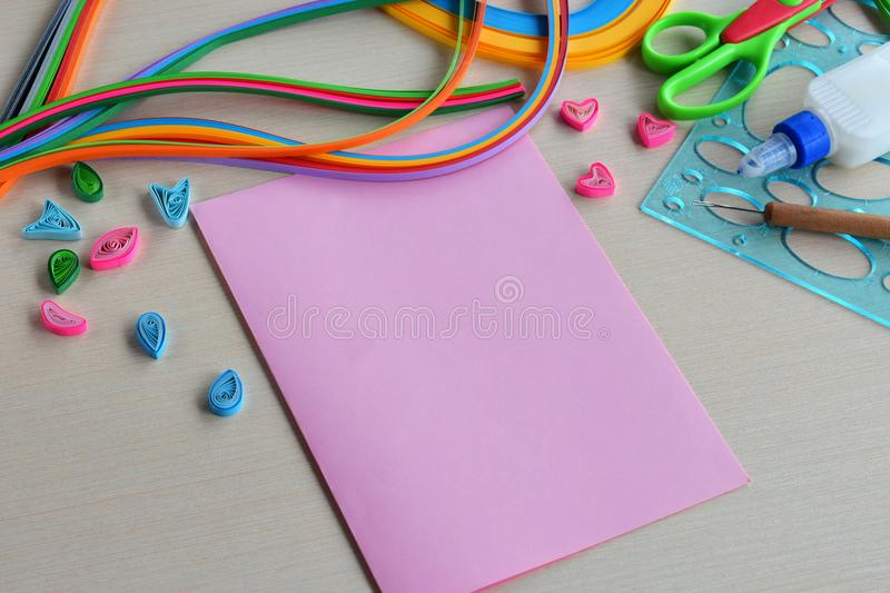 Quilling technique. Handmade crafts on holiday: Birthday, Mother`s or Father`s Day, March 8, Wedding. Children`s DIY concept. P stock image