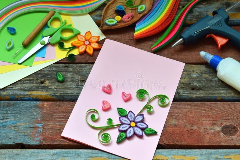Quilling technique. Paper strips, flowers, scissors, elements. Handmade crafts on holiday theme: Birthday, Mother Day, March 8,. Wedding. Making decoration or stock image