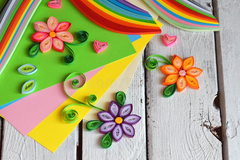Quilling technique. Paper strips, flowers, scissors, elements. Handmade crafts on holiday theme: Birthday, Mother Day, March 8,. Wedding. Making decoration or royalty free stock photo