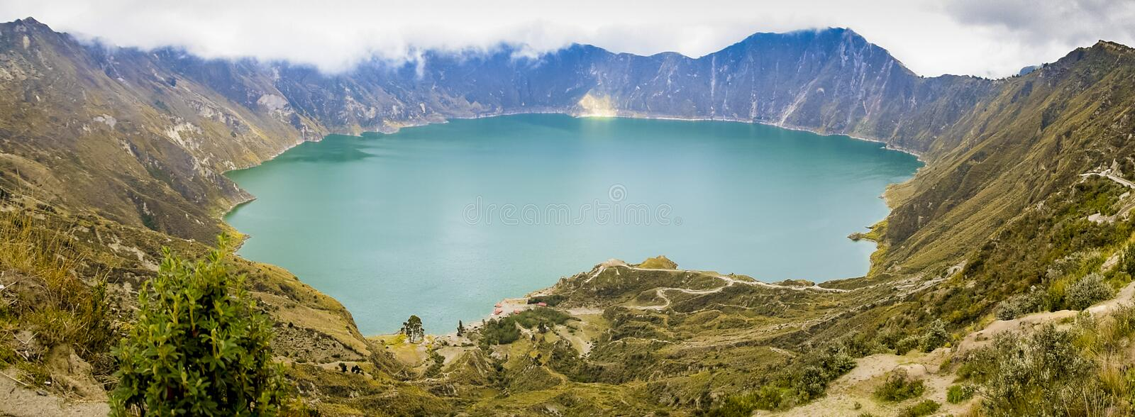 Quilotoa lake in Ecuador. A panoramic view of Quilotoa lake, which is a volcano crater in the Andean Region of Ecuador royalty free stock photos