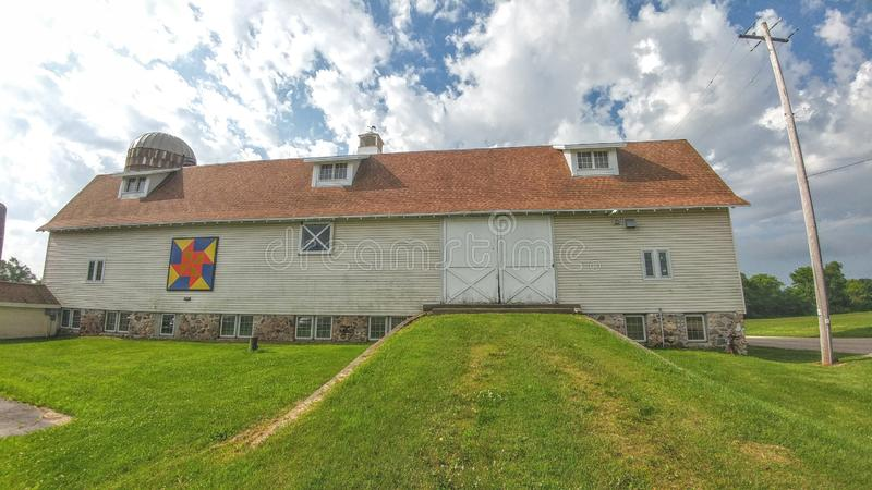 Quilt Barn with Tan Siding in Wisconsin. A quilt barn with a modern looking tan siding barn located in Wisconsin stock images