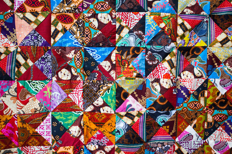 Quilt with distinct color abstract patterns, handmade domestic production royalty free stock photography