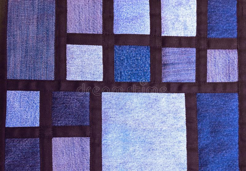 Blue quilt with jeans fabrics royalty free stock photos