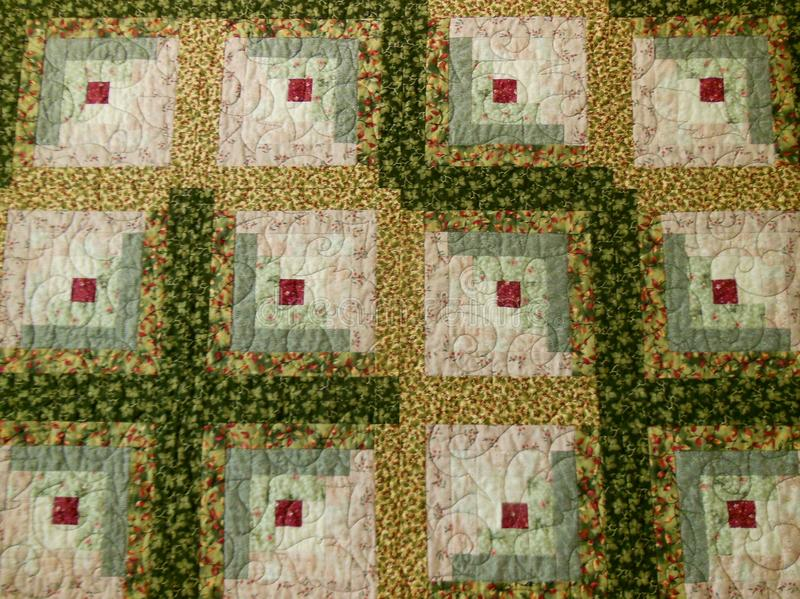 Quilt. Pattern with green, red, tans and whites made into blocks and squares vector illustration