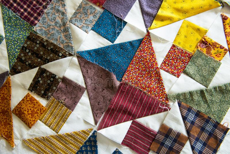 Quilt, Quilting, Sewing, Textiles, Background. Quilting cloth fabric with cut shapes and patterns. Making a quilt and sewing with textiles and cloth is a fun royalty free stock photos