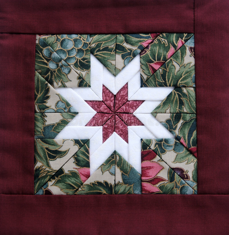 Quilt star maroon royalty free stock images