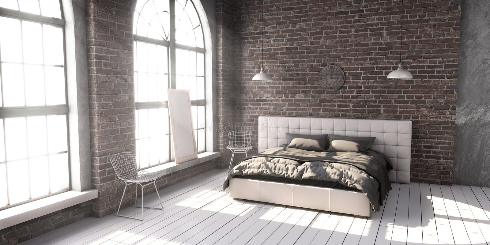 Quilted king size bed in the loft style bedroom. royalty free stock photos