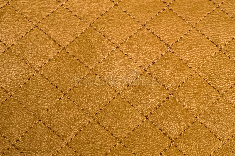 Quilted yellow with gold leather texture stock photos