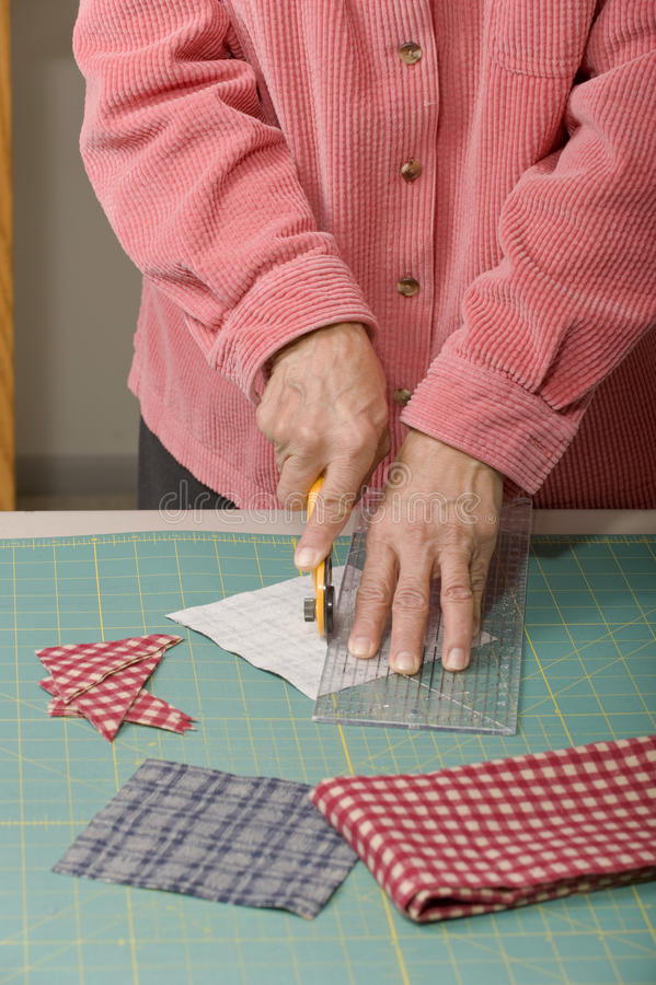 Download Quilter Cutting Fabric Royalty Free Stock Photography - Image: 17947017