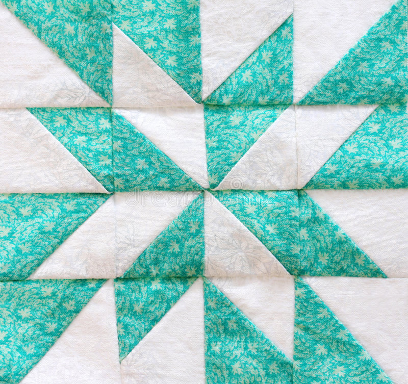 Quilting. Square, in close-up, in shades of green and white stock photos