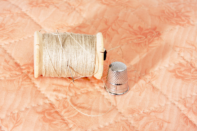 Quilting equipment. Including needle, thread, fabric and thimble stock photo