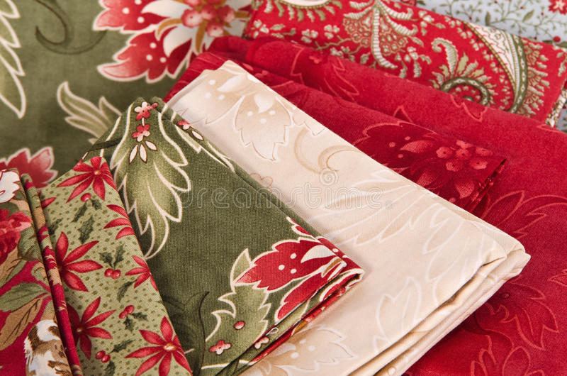 Quilting fabrics. In different colors and patterns stock photography