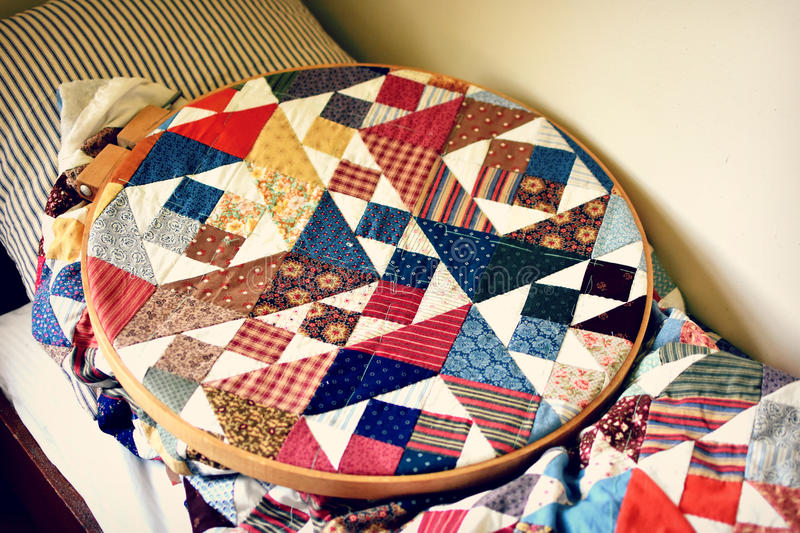 Quilting. A quilting ring with a patchwork quilt being worked on at Old World Wisconsin - a living history museum royalty free stock photography