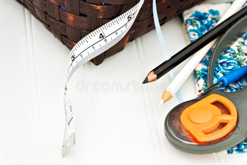 Quilting Supplies. Wooden baskets with various quilting supplies stock photos
