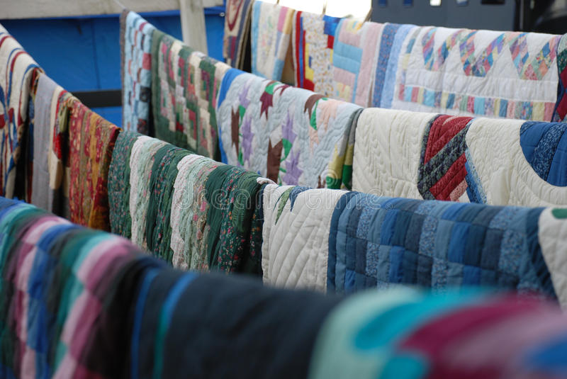 Quilts on a line royalty free stock image