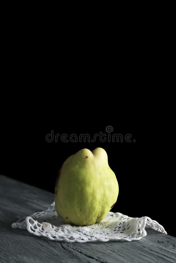 Quince fruit on a wooden table royalty free stock image
